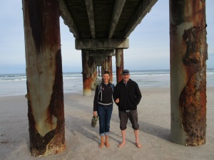 Us under the corroding pier at Saint Augustine Beach.