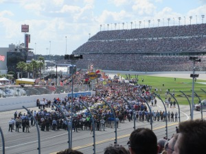 All the cars, teams, sponsors, and crews lined up before the race begins.