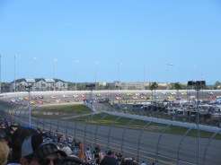 Daytona 500. The cars are sedate and well-spaced because they are following the pace car.